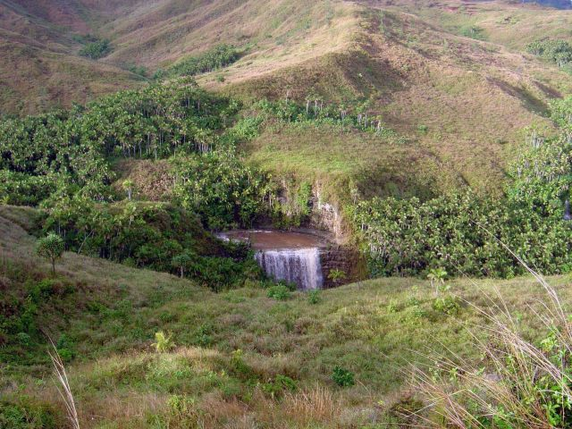 A spring-fed waterfall in the volcanic mountains of Guam. Picture