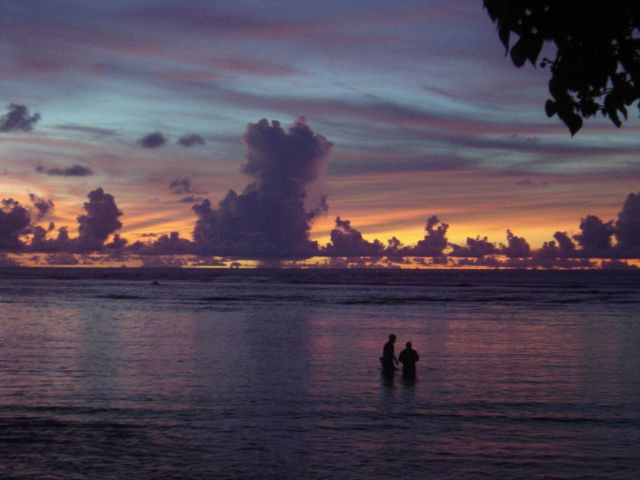 Casting the net in a quiet lagoon at sunset on Guam. Picture