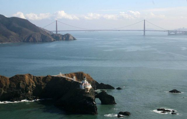 A magnificent view of the Point Bonita Lighthouse with the Golden Gate Bridge in the background. Picture