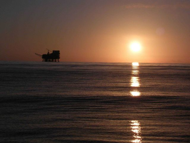 Sunset with an oil rig off Southern California as viewed from the contract fishery research vessel AGRESSOR. Picture