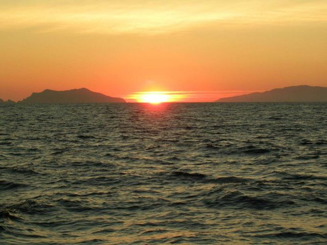 Sunset between Santa Cruz and Anacapa Islands as viewed from the contract fishery research vessel AGRESSOR. Picture