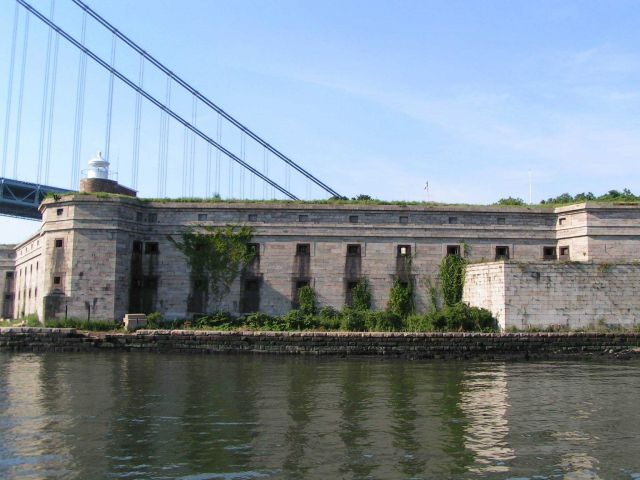 Fort Wadsworth and the Fort Wadsworth Lighthouse on the upper left of the fort with the western terminus of the Verrazano-Narrows Bridge in the backgr Picture