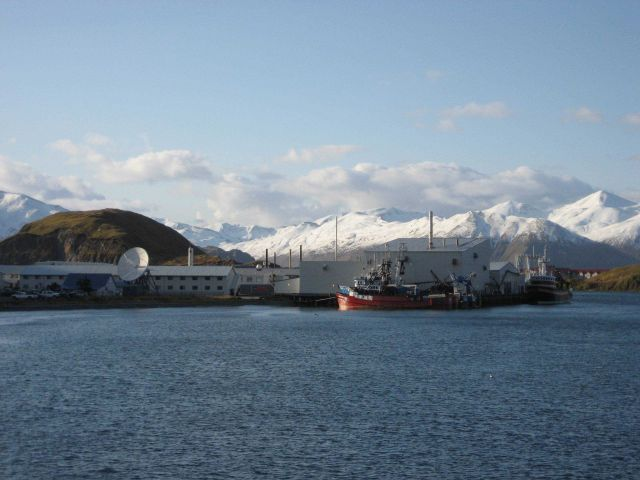 Fishing boats, processing plants, mountains and snow - Dutch Harbor. Picture