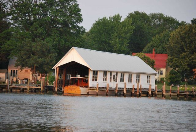 A boat house (garage for floating vehicles) along the Chesapeake Bay. Picture