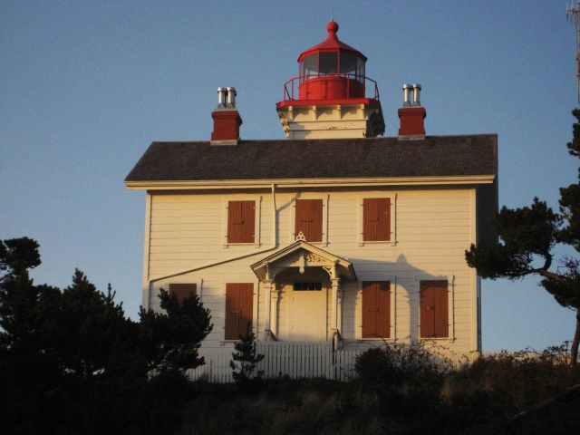 Yaquina Bay Lighthouse illuminated by the late afternoon sun. Picture