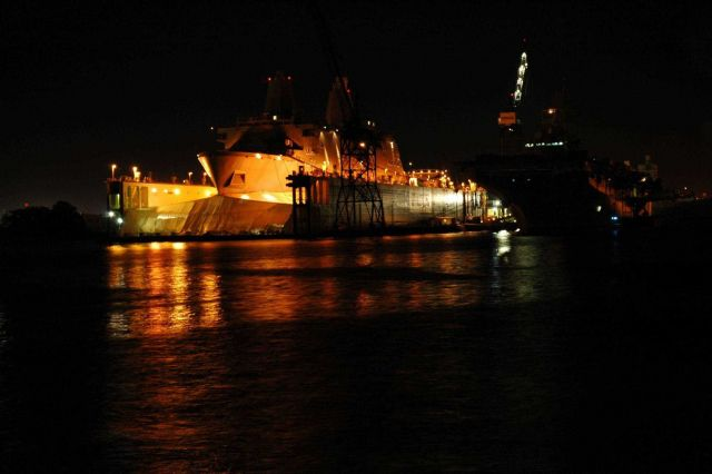 A Norfolk area shipyard seen at night. Picture