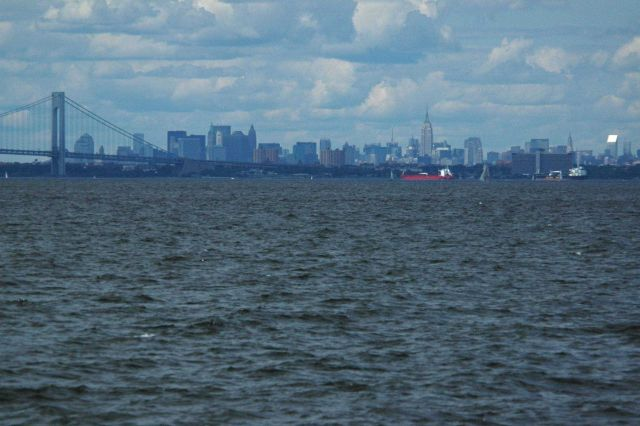 Looking over the east end of the Verrazano Narrows Bridge to Brooklyn and the New York Manhattan skyline beyond Picture
