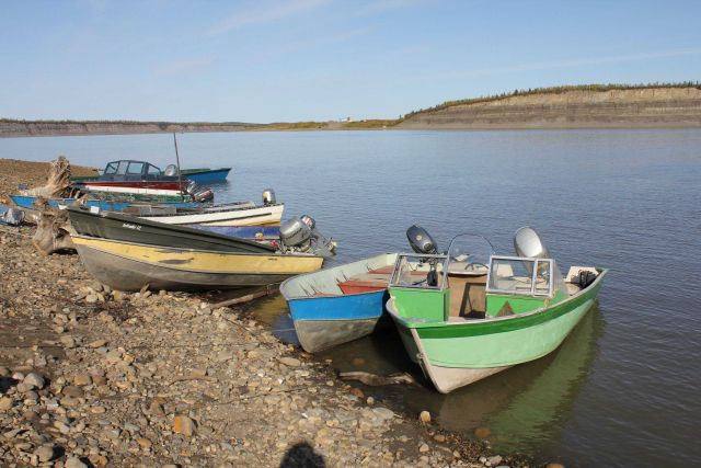 Artisanal native fishing boats on the MacKenzie River at Tsiigehtchic. Picture