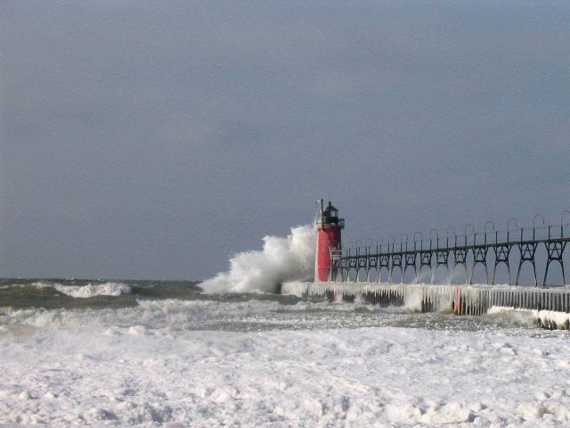 South Haven Lighthouse in a winter storm Picture