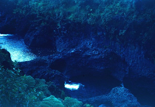 A Hawaiian waterfall seen from the top. Picture