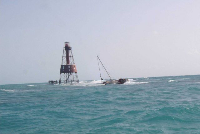 Carysfort Reef Lighthouse with derelict sailboat Picture