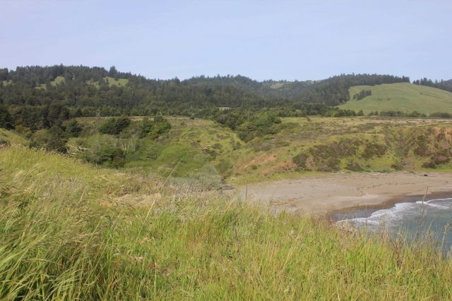 A stream valley leading to the Coast Ranges, coming to the sea at a small cove near Fort Ross. Picture