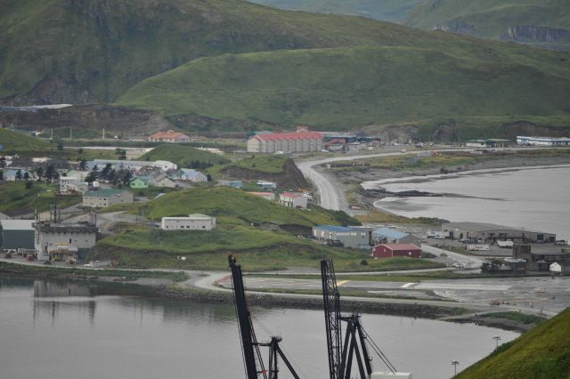 Looking over the American President Lines container cranes to the end of the Dutch Harbor Airport runway and the Grand Aleutian Hotel. Picture