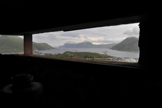 Looking out the view ports of the World War II lookout bunker at Dutch Harbor. Picture