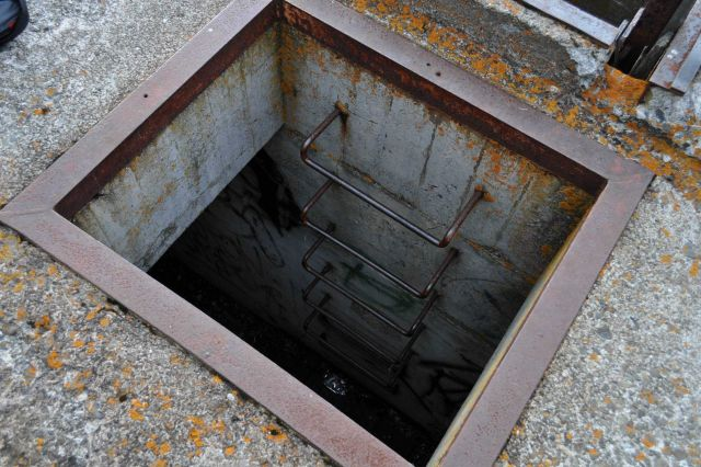 Ladder down to bomb shelter at Dutch Harbor Army lookout bunker dating to World War II. Picture