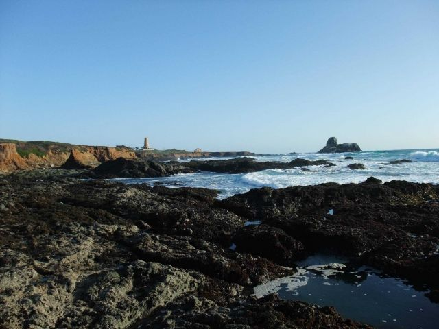 The remains of the Piedras Blancas lighthouse (top was destroyed in an earthquake and removed as a safety measure) and the tide pools to the north. Picture