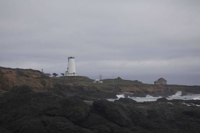 Looking to the south at the renovated Piedras Blancas Lighthouse from the rocky shoreline. Picture