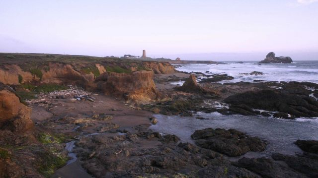 Looking south to the Point Piedras Blancas lighthouse over the shoreline at a medium tide Picture