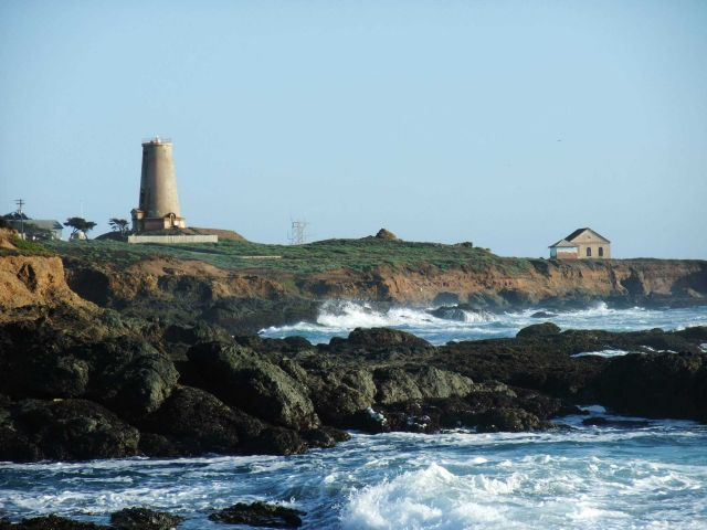 Looking south to the Point Piedras Blancas lighthouse over the shoreline at a high tide Picture