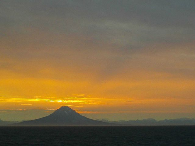 Sunset on Augustine volcano at the SW end of Cook Inlet. Picture