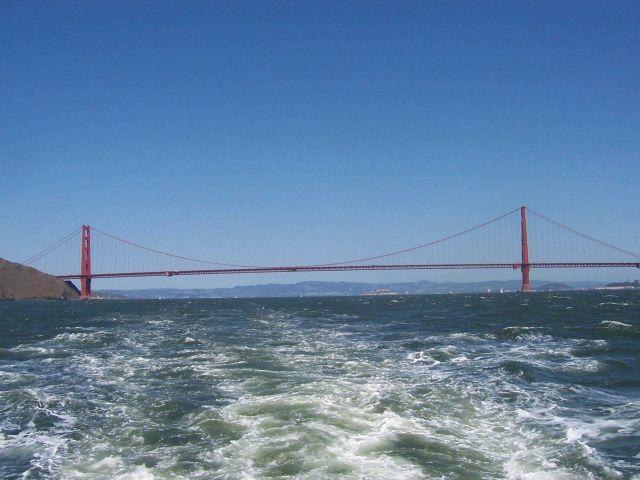 The Golden Gate Bridge seen astern with Alcatraz Island in the right center. Picture