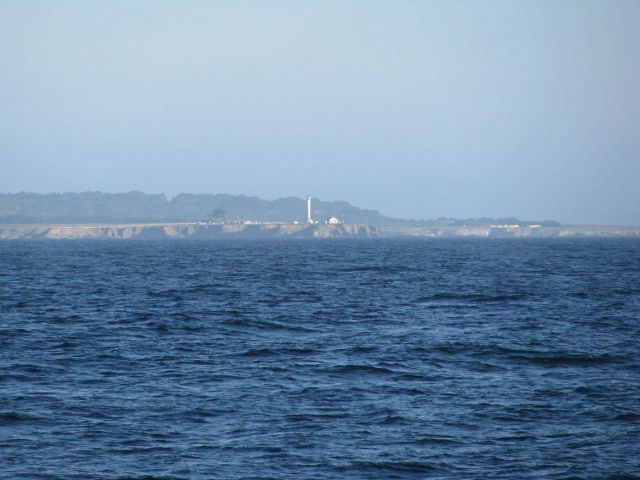 Point Arena Lighthouse seen from offshore. Picture