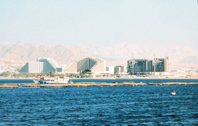 Sea bream aquaculture facility offshore from resort hotels at Eliat, Israel. Picture