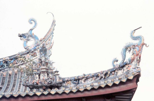 Ornate dragons adorn a temple roof. Picture