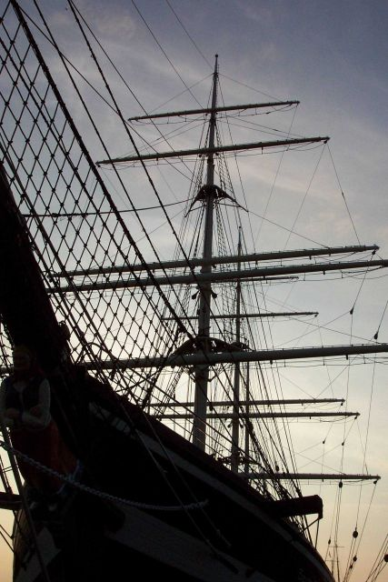 A sailing ship silhouetted in the sunset at the Bremerhaven Maritime Museum. Picture