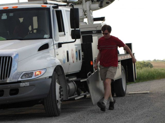 NSSL's Ted Mansell pulls out plates to help stabilize the NOAA X-Pol mobile radar. Picture