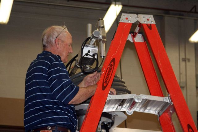 Dennis Nealson working on an anemometer in the NSSL truck bay Picture