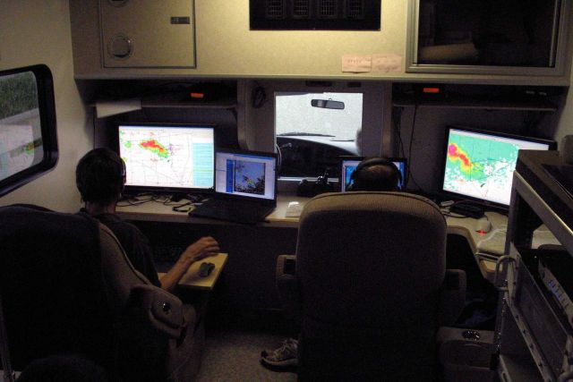 Erik Rasmussen and David Dowell coordinate VORTEX II intercept operations from the Field Command Vehicle. Picture