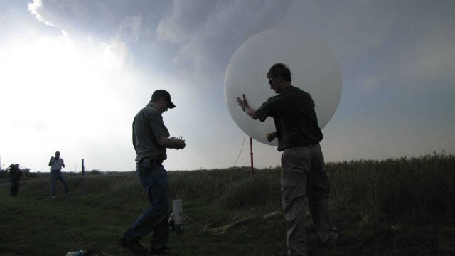 Launching a weather balloon on the periphery of a supercell thunderstorm. Picture