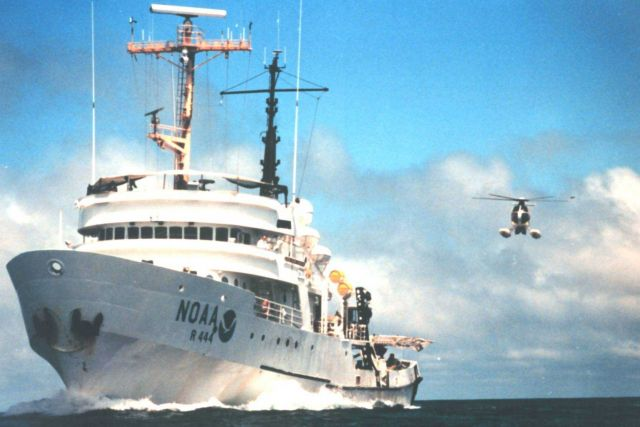 NOAA Ship DAVID STARR JORDAN and MD500 helicopter during marine mammal studies in the tropical east Pacific Ocean. Picture