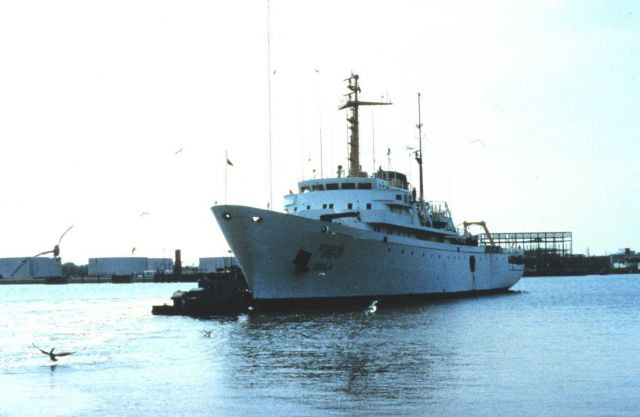 The NOAA Ship RESEARCHER being maneuvered by harbor tugs while in shipyard. Picture