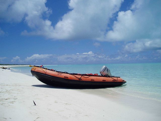 Small boat from HI'IALAKAI on beach of island in NW Hawaiian Islands Picture
