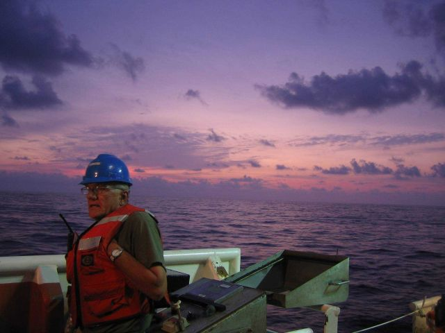 Crew on watch at sunrise during MOCNESS sampling off the NOAA Ship GORDON GUNTER . Picture