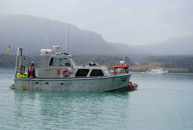 Jensen survey launch and rigid-hull inflatable boat supporting tide gage installation Picture