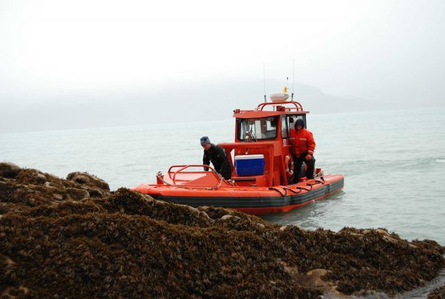 Rigid hull inflatable boat (RHIB) supporting tide gage operations. Picture
