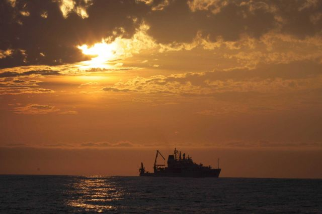 NOAA Ship PISCES silhouetted in the sunset Picture