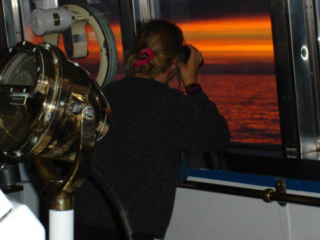 Lookout on watch at sunset on NOAA Ship MILLER FREEMAN. Picture