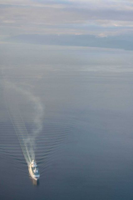 Cruise ship at sunset during a flight home after a successful NOAA-led humpback whale disentanglement. Picture