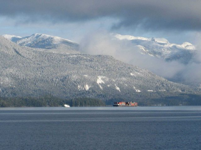 Tug and barge in the Inside Passage after a dusting of snow on the mountains. Picture