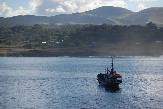 A fishing boat hailing from Valparaiso, 2000 miles away, anchored off Easter Island. Picture