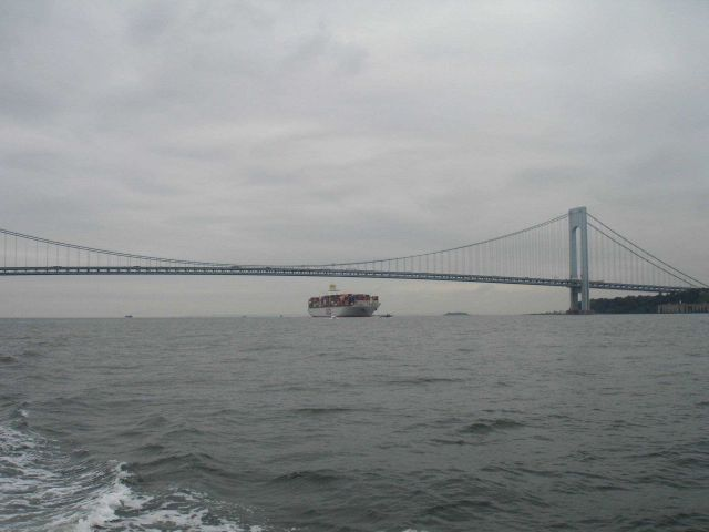Inbound container ship passing under Verrazano Narrows Bridge. Picture