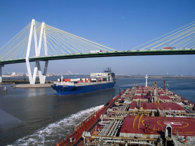A container ship and a tanker passing each other at the Sunshine Skyway Bridge in Tampa. Picture