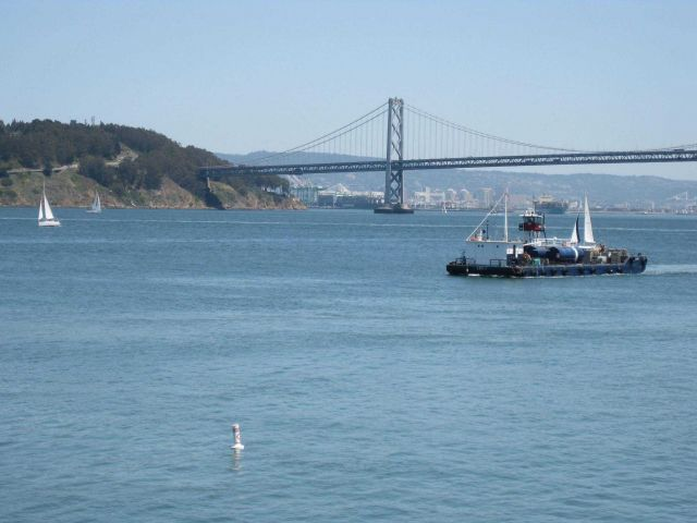 A self-propelled barge plying the waters of San Francisco Bay having just sailed under the Bay Bridge headed north. Picture