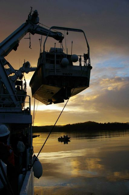NOAA survey launch 2807 being secured at sunset. Picture