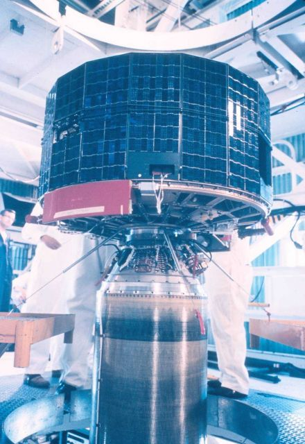 TIROS satellite mated to rocket for launching. Picture