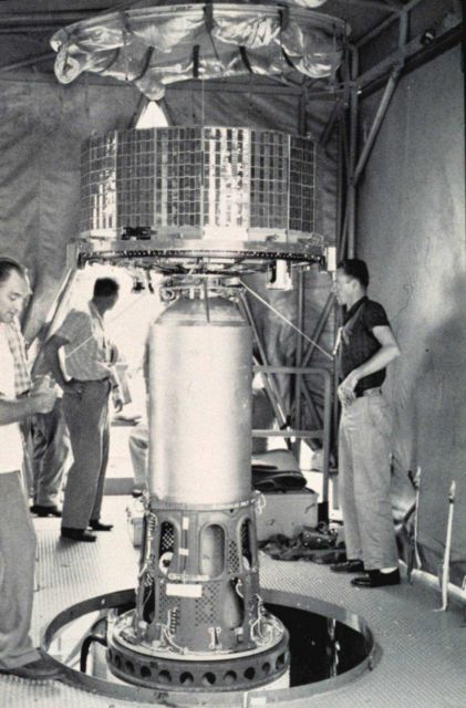Mounting early TIROS satellite on nose of rocket prior to launch Picture
